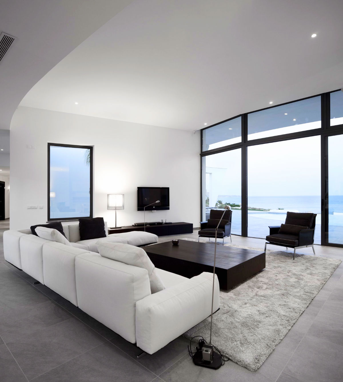 living-room-sets-ocean-view-floor-lamps-white-couches-rectangle-wood-coffee-table-large-material-rug-tv-cabinet